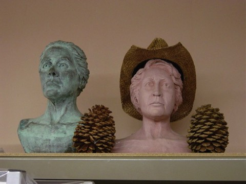 Plaster (green) and clay portraits